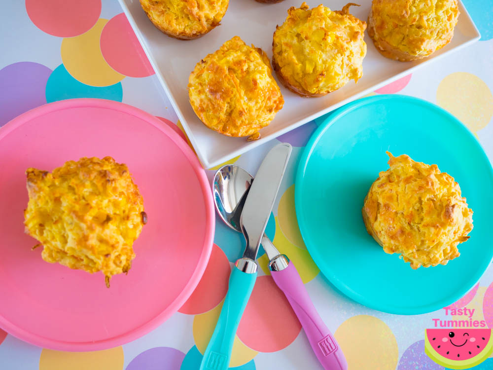 carrot, corn, cheese and chive muffins on a tray