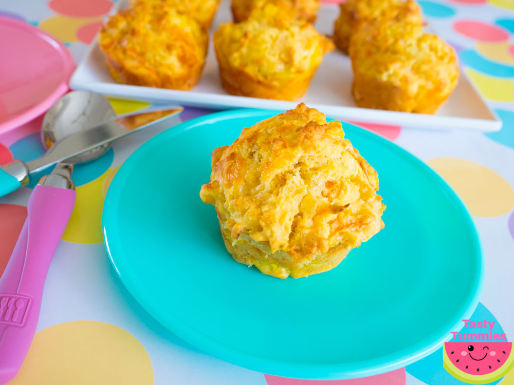 carrot, corn, cheese and chive muffins, closeup